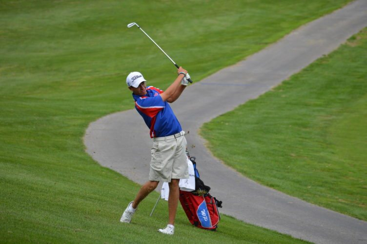 Photo by Cody Tomer Wheeling Park's Jacob Nickell swings for the green on the first hole at the Jones Course at Oglebay on Thursday.