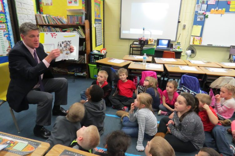 Photo Provided Ohio County Schools Federal Programs Director Walt Saunders reads to students at Elm Grove Elementary School during the 2016-17 school year.