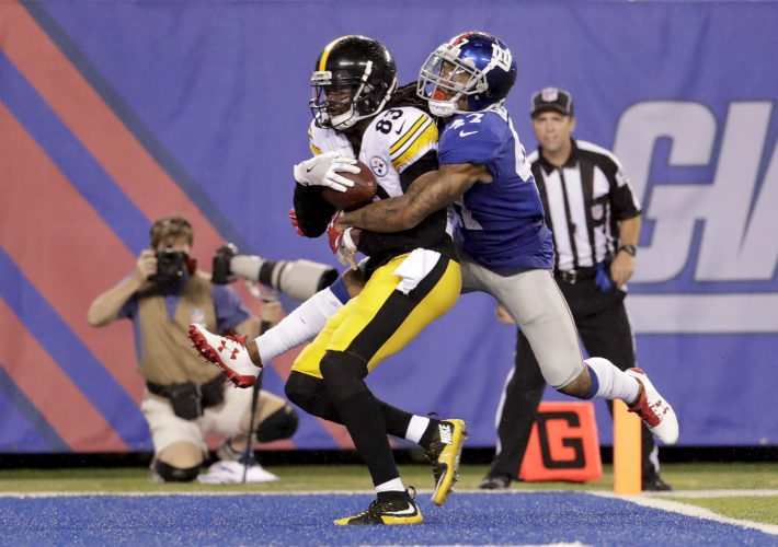 Pittsburgh Steelers wide receiver Cobi Hamilton (83) scores a touchdown against New York Giants defensive back Valentino Blake (47) during the second quarter of a preseason NFL football game, Friday, Aug. 11, 2017, in East Rutherford, N.J. (AP Photo/Julio Cortez)