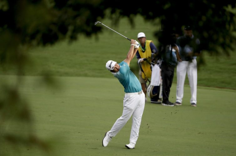 Hideki Matsuyama of Japan, hits from the fairway on the 18th hole during the second round of the PGA Championship golf tournament at the Quail Hollow Club Friday, Aug. 11, 2017, in Charlotte, N.C. (AP Photo/Chris O'Meara)