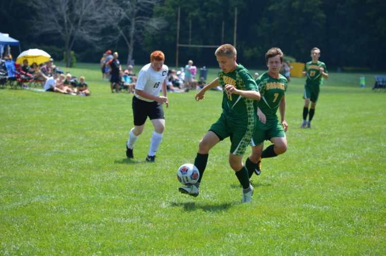 Photos by Cody Tomer Brooke's Nick Cruny (31) controls the ball, while teammate Konner Govey (7) looks on during the Soccer-Rama at Brooke on Saturday.