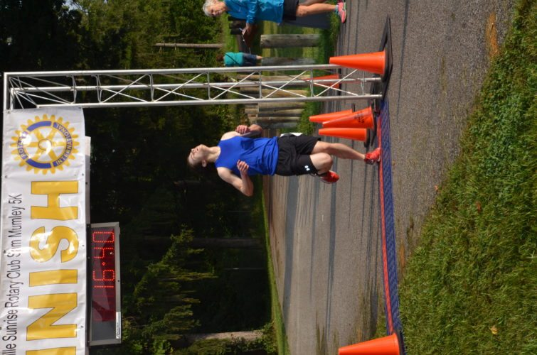Photo by Kim North St. Clairsville's Kyle Timko finishes first during the Sam Mumley 5K on Saturday morning.