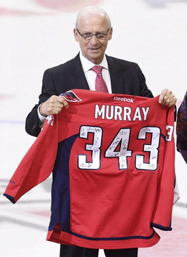 "This Jan. 24, 2017 photo shows senior hockey advisor to the Ottawa Senators, Bryan Murray, holding a signed Washington Capitals jersey as he is inducted as the first member of the Ottawa Senators new ""ring of honour,"" in Ottawa. The Ottawa Senators say former NHL coach and general manager Bryan Murray has died at age 74. He was diagnosed with stage 4 colon cancer in 2014. (Sean Kilpatrick/The Canadian Press via AP)"