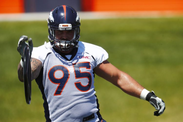 FILE - This June 5, 2017 file photo shows Denver Broncos defensive end Derek Wolfe taking part in a drill during the team's NFL football minicamp session in Englewood, Colo. The Denver Broncos' battered defensive line took another huge hit Saturday, Aug. 12, 2017 when Wolfe was carted off the field after injuring his right leg on the second snap of team drills. (AP Photo/David Zalubowski, file)