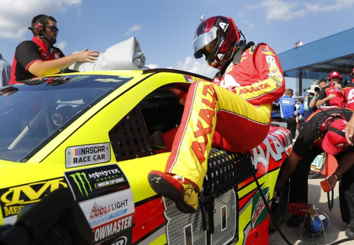 Dale Earnhardt Jr. enters his car for qualifying for the NASCAR Cup Series auto race in Brooklyn, Mich., Friday, Aug. 11, 2017. (AP Photo/Paul Sancya)