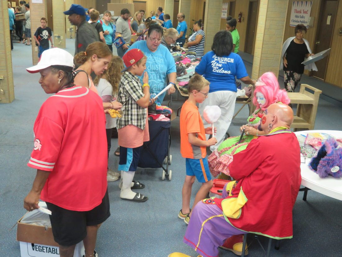 Photo by Alec Berry Clowns entertain guests at Saturday's Adopt-A-Student event in North Wheeling.