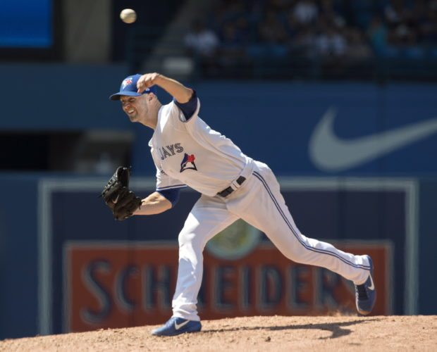 Toronto Blue Jays starting pitcher J.A Happ throws against the Pittsburgh Pirates during the fifth inning of a baseball game in Toronto, Sunday, Aug. 13, 2017. (Fred Thornhill/The Canadian Press via AP)