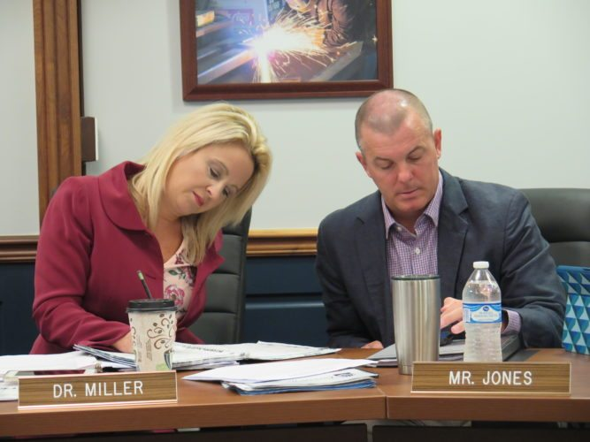 Photo by Joselyn King Ohio County Schools Superintendent Kim Miller and Assistant Superintendent Rick Jones this morning review details of a gas lease agreement.