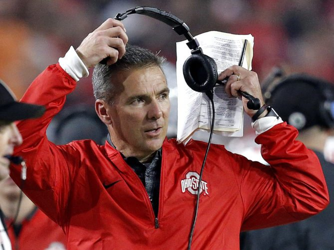 FILE - In this Dec. 31, 2016, file photo, Ohio State head coach Urban Meyer takes off his headset during the second half of the Fiesta Bowl NCAA college football game against Clemson, in Glendale, Ariz. The backup quarterback derby at Ohio State continues furiously without a decision on whether Joe Burrow or Dwayne Haskins would be the next man up. Coach Urban Meyer on Monday, Aug. 14, 2017,  wouldn't say who has the edge. He said he's looking for consistent performance.(AP Photo/Ross D. Franklin, File)