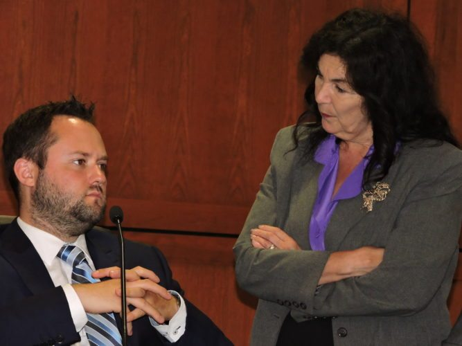 Photo by Casey Junkins Wheeling City Solicitor Rosemary Humway-Warmuth speaks with Vice Mayor Chad Thalman during a break in Tuesday's city council meeting.