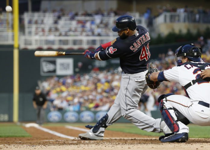 Cleveland Indians' Carlos Santana hits a solo home run off Minnesota Twins pitcher Bartolo Colon in the fourth inning of a baseball game Tuesday, Aug. 15, 2017, in Minneapolis. (AP Photo/Jim Mone)