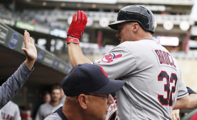 Cleveland Indians' Jay Bruce, right, is greeted in the dugout after his solo home run off Minnesota Twins pitcher Aaron Slegers during the fourth inning of the second game of a baseball doubleheader Thursday, Aug. 17, 2017, in Minneapolis. (AP Photo/Jim Mone)