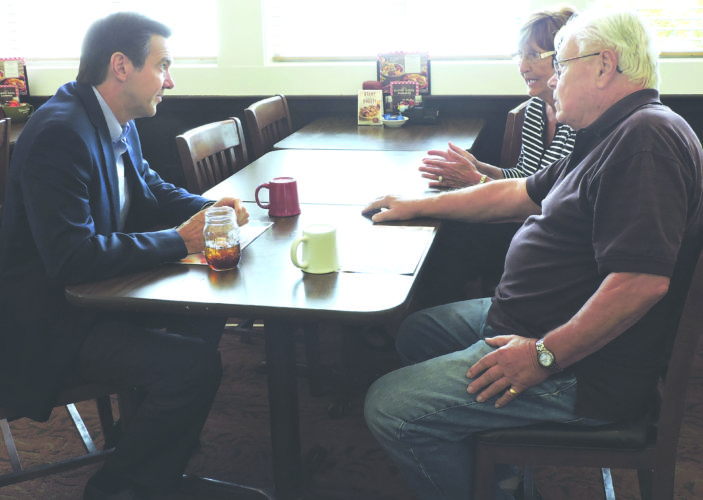 Photo by Craig Howell U.S. Rep. Evan Jenkins, R-W.Va., left, speaks with Steve and Beverly Spiewak while visiting Weirton this week. Jenkins is running for a U.S. Senate seat next year.