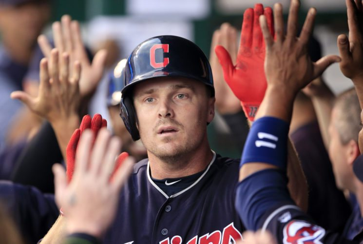 Cleveland Indians' Jay Bruce celebrates with teammates following his two-run home run off Kansas City Royals starting pitcher Ian Kennedy during the first inning of a baseball game at Kauffman Stadium in Kansas City, Mo., Friday, Aug. 18, 2017. (AP Photo/Orlin Wagner)
