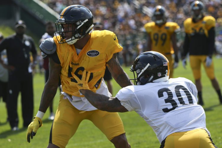 Pittsburgh Steelers inside linebacker Ryan Shazier (50) and running back James Conner (30) battle during practice at NFL football training camp in Latrobe, Pa., Sunday, July 30, 2017 . (AP Photo/Keith Srakocic)