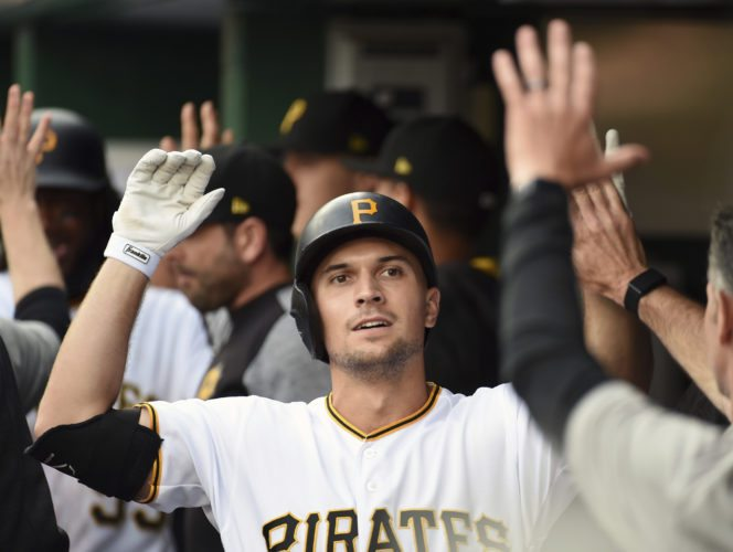 Pittsburgh Pirates' Adam Frazier is congratulated by teammates after hitting a two-run home run in the second inning of a baseball game against the St. Louis Cardinals in Pittsburgh, Saturday, Aug. 19, 2017. (AP Photo/Fred Vuich)