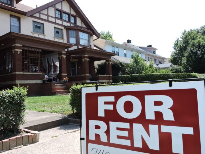 """Photo by Casey Junkins Wheeling leaders may adopt a """"non-owner occupied property registration program,"""" part of which could lead to inspections of rental units, such as these on National Road."""