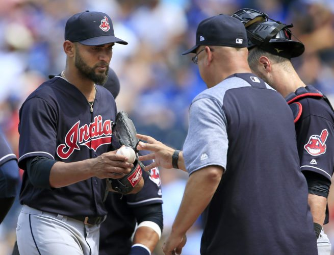 Cleveland Indians starting pitcher Danny Salazar, left, hands the ball to manager Terry Francona, right, during the fifth inning of a baseball game against the Kansas City Royals at Kauffman Stadium in Kansas City, Mo., Sunday, Aug. 20, 2017. (AP Photo/Orlin Wagner)