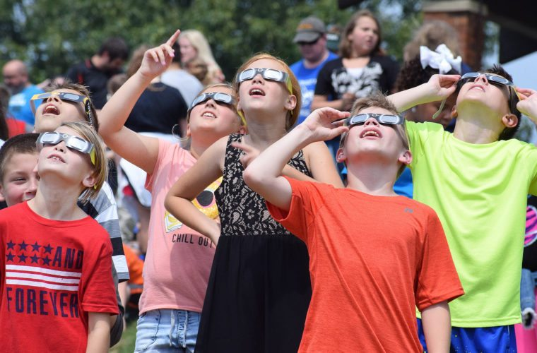 Photo by Scott McCloskey Hundreds of Marshall County middle and grade school students participate in an educational solar eclipse event at Grand Vue Park in Moundsville on Monday, including from left, Tate Pelly of Center McMechen Elementary, Xavier Ellis of Hilltop Elementary, Megan Gary and Arionna Frame of Center McMechen, Zach Neilson of Sherrard Middle, and Zack Freeborough of Center McMechen.