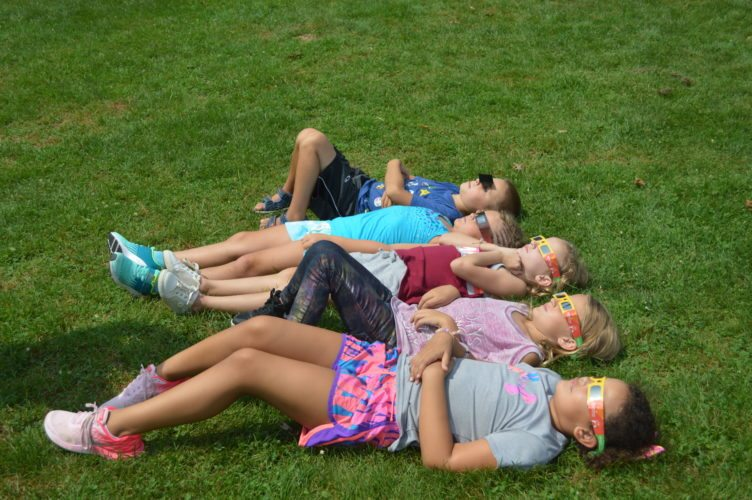 Photo by Jessica Broverman Wheeling Country Day School students enjoy a relaxing way to watch the Monday solar eclipse. From top are Zander Kaleum, Anneliese Tennant, Grace Norman, Vivi Slack and Lilly Smith.