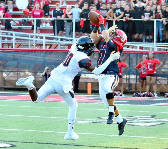 Photo by Michael D. McElwaiin Steubenville's Gino Pierro nearly hauls in a pass against Upper St. Clair on Friday.
