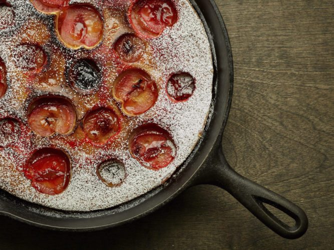 This Aug. 17, 2017 photo provided by The Culinary Institute of America shows a plum clafoutis in Hyde Park, N.Y. This dish is from a recipe by the CIA. (Phil Mansfield/The Culinary Institute of America via AP)