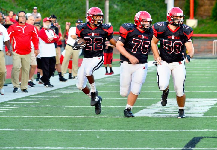Photos by Michael D. McElwain Steubenville's Caleb Mitchell (22) rumbles down field behind  blocks from Caleb Brown (75) and Alijah Demitras (56).