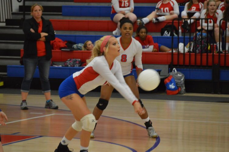 Photo by Kyle Lutz Wheeling Park's Cameron Lloyd returns a serve against Brooke while Ateria Walker (8)looks on.