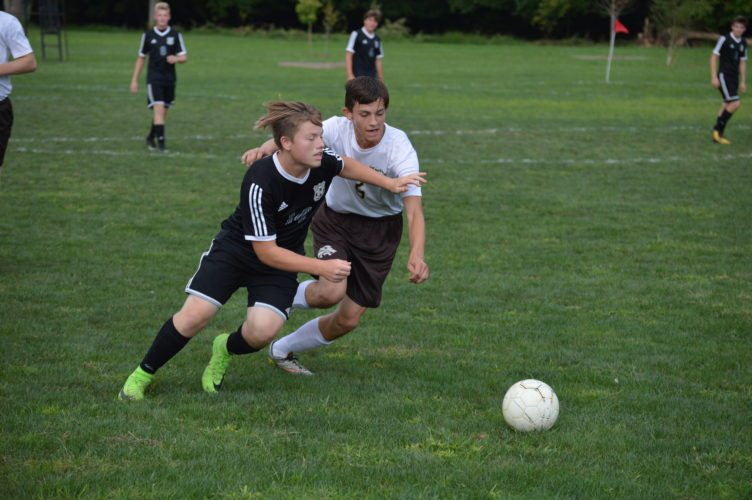 Tyler  Consolidated's Colin Munoz (left) and John Marshall's Hayden Thomas (right) battle for the ball during Wednesday's match at John  Marshall.     Photo by  Cody Tomer