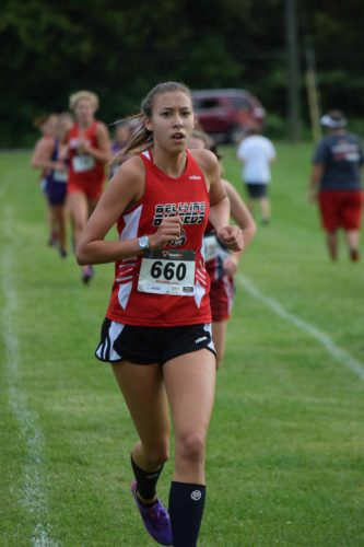 Photo by Seth Staskey Bellaire's Sydney Purtiman runs to an eighth place finish as the Big Reds secure a Buckey 8 title.