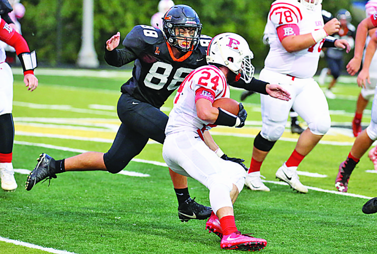Photo by Alex Kozlowski Linsly's Cyrus Hill (88) makes a play on Beaver Local's Torey Calio during Friday night's game at West Liberty.