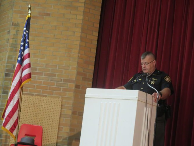 Photo by Alec Berry  Guernsey County Deputy Sheriff Jeff Heshbaum speaks at a 9/11 memorial service at Union Local Middle School on Saturday.