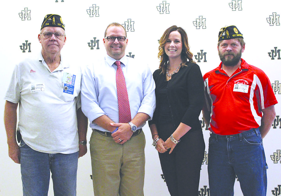 "Photo Provided American Legion Post 114 member Robert Pope, left, and American Legion Post 3 member Allen Hall, right, recognize John Marshall High School teachers David Parsons and Erin Parsons as the Legion's 2017-18 ""Educators of the Year."""