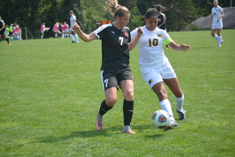 West  Liberty's Briella  Taylor (10) battles for possession with  Wheeling Jesuit's Kayla Klock (7) during Sunday's MEC match at West Liberty.  Photo by  Josh Strope