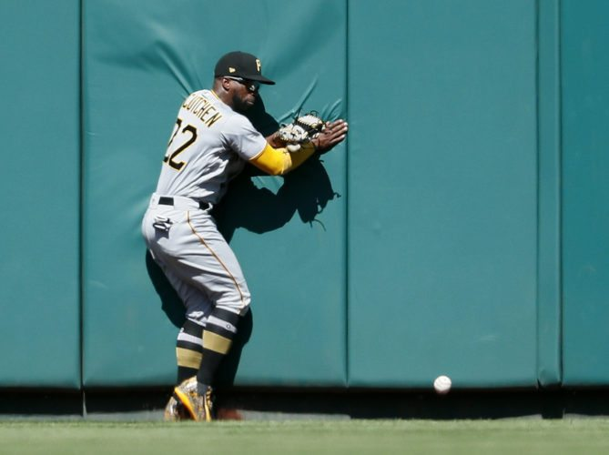 Pittsburgh Pirates center fielder Andrew McCutchen is unable to catch a double by St. Louis Cardinals' Harrison Bader during the sixth inning of a baseball game, Sunday, Sept. 10, 2017, in St. Louis. (AP Photo/Jeff Roberson)