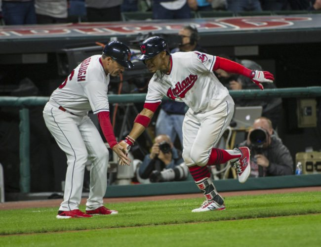 Cleveland Indians' Francisco Lindor is greeted by third base coach Mike Sarbaugh after Lindor's solo home run off Baltimore Orioles starting pitcher Jeremy Hellickson during the sixth inning of a baseball game in Cleveland, Sunday, Sept. 10, 2017. (AP Photo/Phil Long)