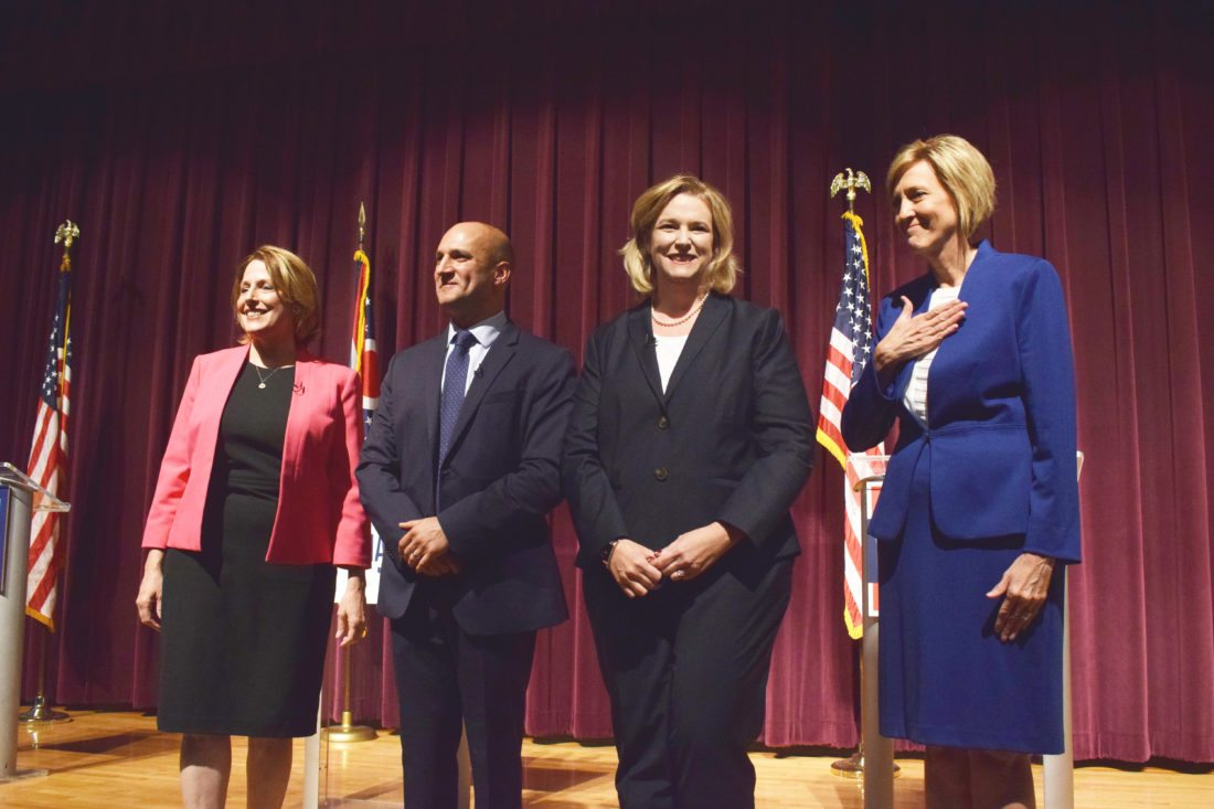 Photo by Scott McCloskey Ohio Democratic gubernatorial candidates posing for a photo at center stage after their first debate Tuesday at Martins Ferry High School, from left, are former state Rep. Connie Pillich; Ohio Sen. Joe Schiavoni, D-Boardman; Dayton Mayor Nan Whaley; and former U.S. Rep. Betty Sutton.