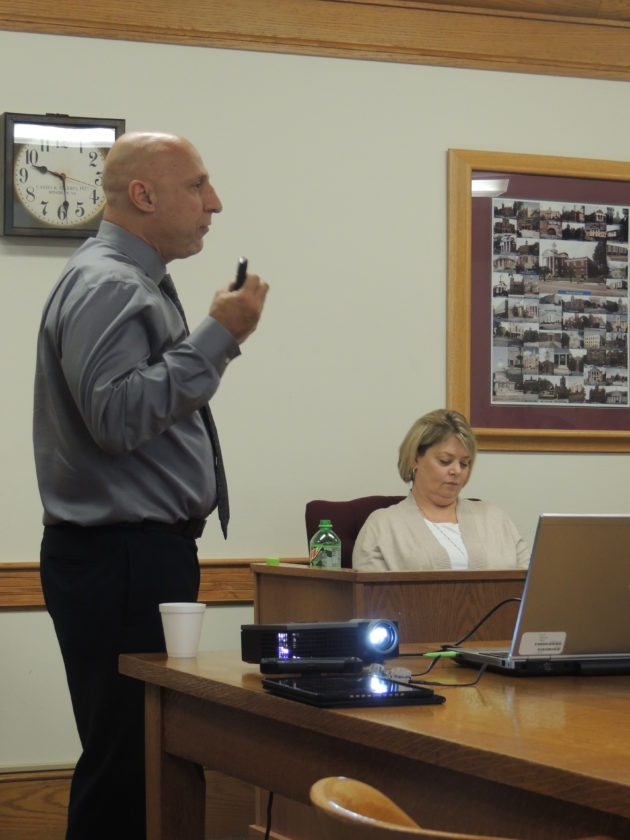 Photo by Drew Parker Gus Suwaid, West Virginia Division of Highways District 6 engineer, addresses Marshall County commissioners Tuesday.