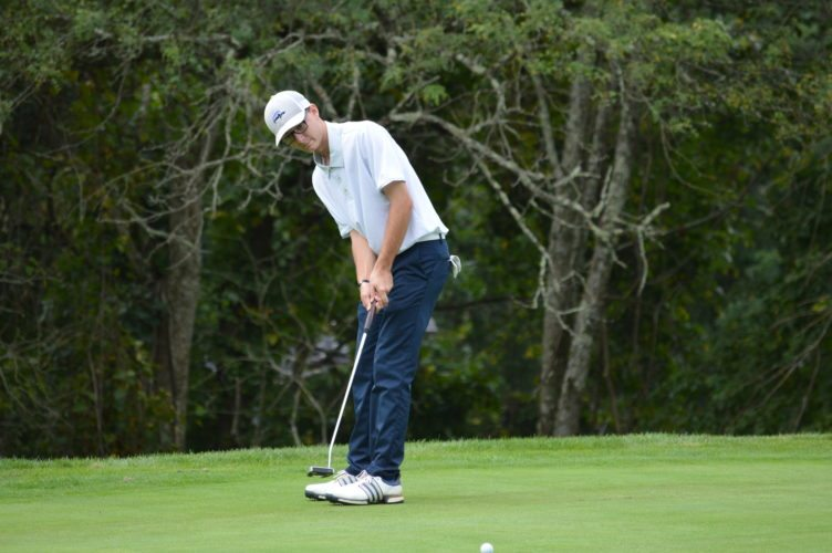 Photo by Cody Tomer Madonna's Howie Peterson putts on the 17th green of Tuesday's 1A-2A OVAC golf championship.