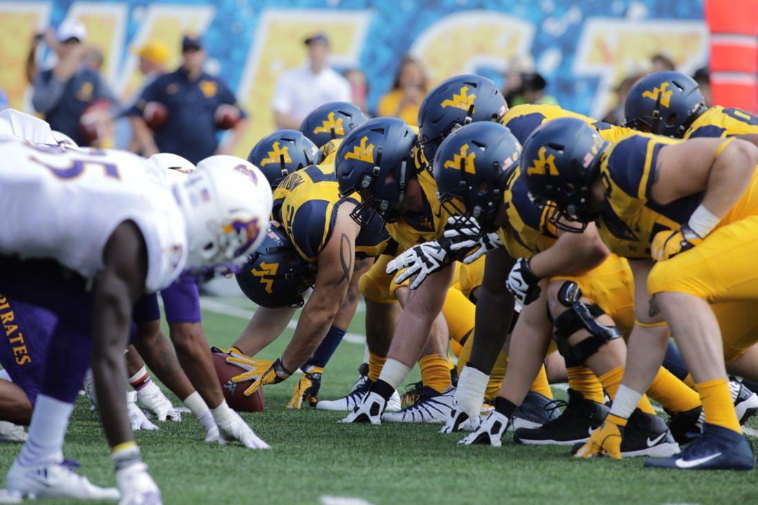 during the first half/second half of an NCAA college football game, Saturday, Sept. 9, 2017, in Morgantown, W.Va. (AP Photo/Raymond Thompson)