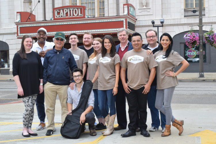 "Gathered before their first ""Ticket to Nashville"" rehearsal  at the historic    Capitol Theatre on Main Street in Wheeling Thursday are, kneeling, lead Tristen Smith, standing from left, stage manager Jana Jarrett, musical director Kevin Dorsey, actor Terry Kiser, actor Woody Pond, actor Matt Van Fossen, actor Molly Malady, actor Kaileigh Bullard, co-producer Rob Capehart, director Demetrius Navarro, co-producer and writer Ty DeMartino and Erlinda     Navarro. The cast rehearsed for 11 days at the Strand Theatre in Moundsville before moving to the    Capitol last week. Photo by Scott McCloskey"