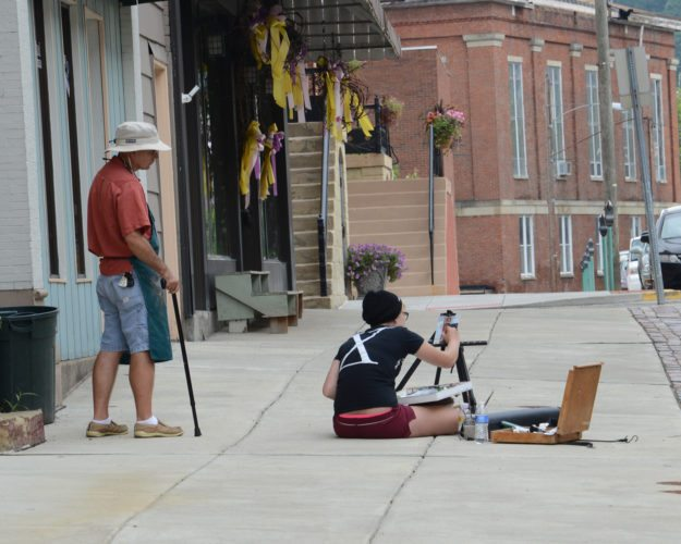 Painters participate in a past Paint Historic Wheeling outdoor (or plein air) session on Market Street in Center Wheeling. Paint        Historic  Wheeling, organized by  Artworks Around Town, will take place this year Sept. 28-Oct. 1.  Photo  Provided