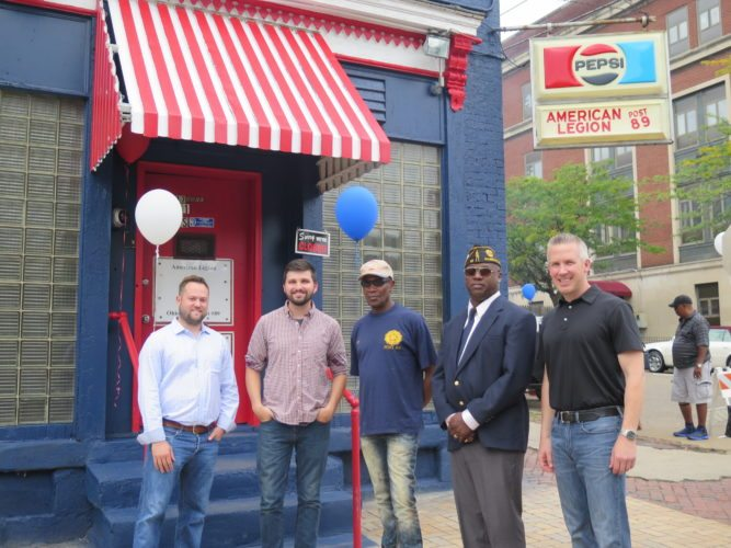 American Legion Post 89 members and Wheeling leaders join Saturday to celebrate the grand re-opening of the post home, located at 15th and Jacob streets. Gathered, from left, are Wheeling Vice Mayor Chad Thalman, Councilman Brian Wilson, bar manager James Martin, post  Commander Demetrius Lathon and Mayor Glenn Elliott.  Photo by Joselyn King