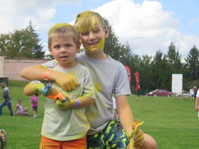 Photo by Alec Berry Grady Rolling, left, and Ethan Rolling enjoy Saturday's Festival of Colors at the Palace of Gold in New Vrindaban.