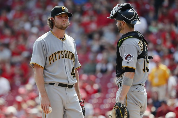 Pittsburgh Pirates starting pitcher Gerrit Cole, left, waits to be relieved alongside catcher Chris Stewart, right, in the sixth inning of a baseball game against the Cincinnati Reds, Sunday, Sept. 17, 2017, in Cincinnati. The Reds 5-2. (AP Photo/John Minchillo)
