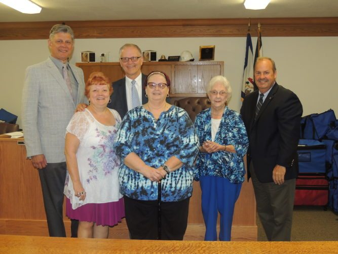 Photo by Drew Parker Marshall County commissioners honor retired school employees Tuesday. From left are Commissioner John Gruzinskas, West Virginia Association of Retired School Employees member Linda Snodgrass, Commission President Bob Miller, retirees' association members Pam Schimmel and Myrtle Garten and Commissioner Scott Varner.