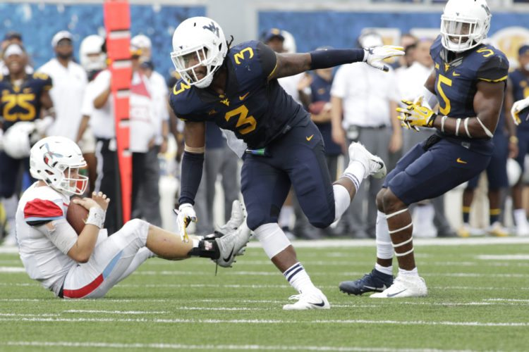 West Virginia linebacker Al-Rasheed Benton (3) celebrates after sacking Delaware State quarterback Jack McDaniels during the first half of an NCAA college football game, Saturday, Sept. 16, 2017, in Morgantown, W.Va. (AP Photo/Raymond Thompson)