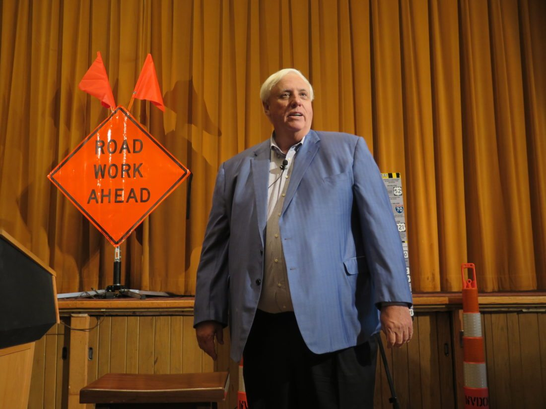 Photo by Joselyn King West Virginia Gov. Jim Justice looks out at the crowd before sitting down for a town hall forum Wednesday afternoon in the Glessner Auditorium at Oglebay Park's Wilson Lodge. Justice came to Wheeling and Weirton Wednesday to discuss the state's upcoming road bond referendum election set for Oct. 7.