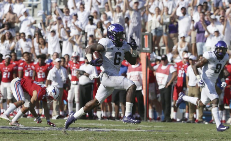 TCU running back Darius Anderson (6) breaks away on a touchdown run past SMU defensive back Jordan Wyatt (15) during the second half an NCAA college football game in Fort Worth, Texas, Saturday, Sept. 16, 2017. TCU won 56-36. (AP Photo/LM Otero)
