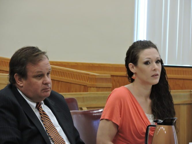 Photo by Alan Olson Leslie Morris appears Thursday in Marshall County Circuit Court with her attorney, David White, to plead guilty to a third-offense shoplifting charge.
